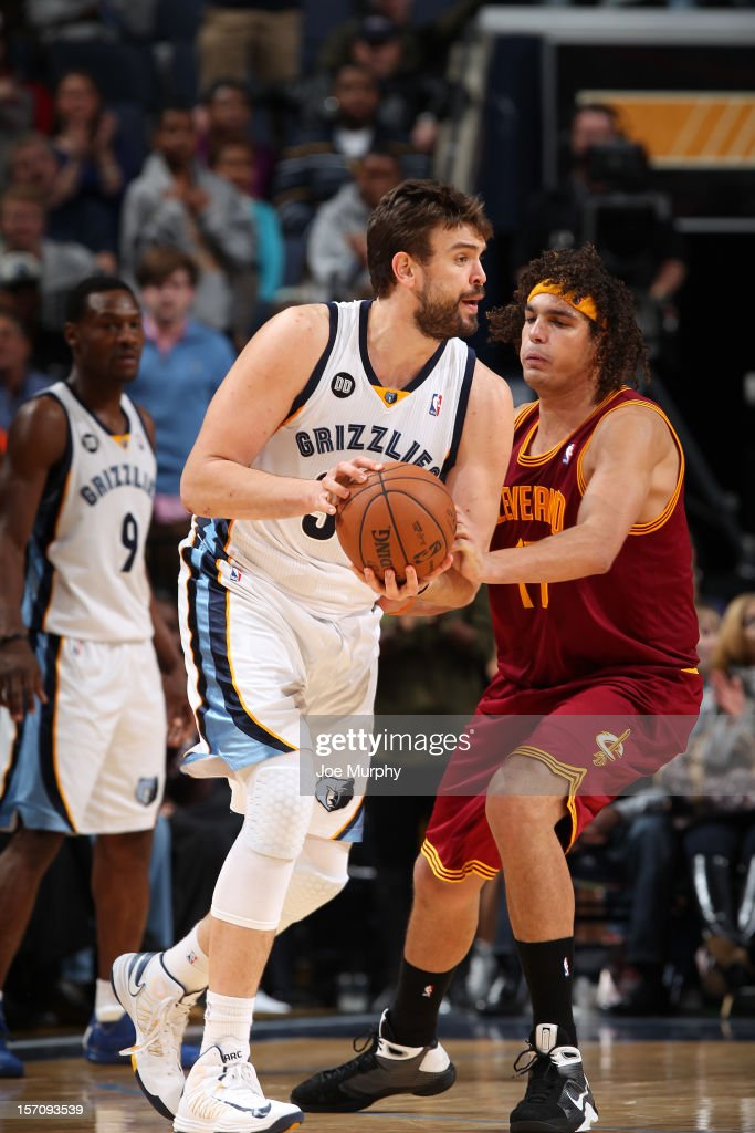 <a gi-track='captionPersonalityLinkClicked' href=/galleries/search?phrase=Marc+Gasol&family=editorial&specificpeople=661205 ng-click='$event.stopPropagation()'>Marc Gasol</a> #33 of the Memphis Grizzlies controls the ball against <a gi-track='captionPersonalityLinkClicked' href=/galleries/search?phrase=Anderson+Varejao&family=editorial&specificpeople=202247 ng-click='$event.stopPropagation()'>Anderson Varejao</a> #17 of the Cleveland Cavaliers on November 26, 2012 at FedExForum in Memphis, Tennessee.