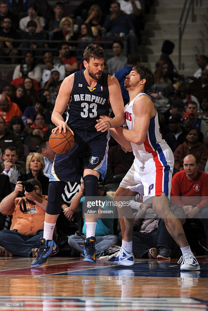 Marc Gasol #33 of the Memphis Grizzlies controls the ball against Viacheslav Kravtsov #55 of the Detroit Pistons on February 19, 2013 at The Palace of Auburn Hills in Auburn Hills, Michigan.
