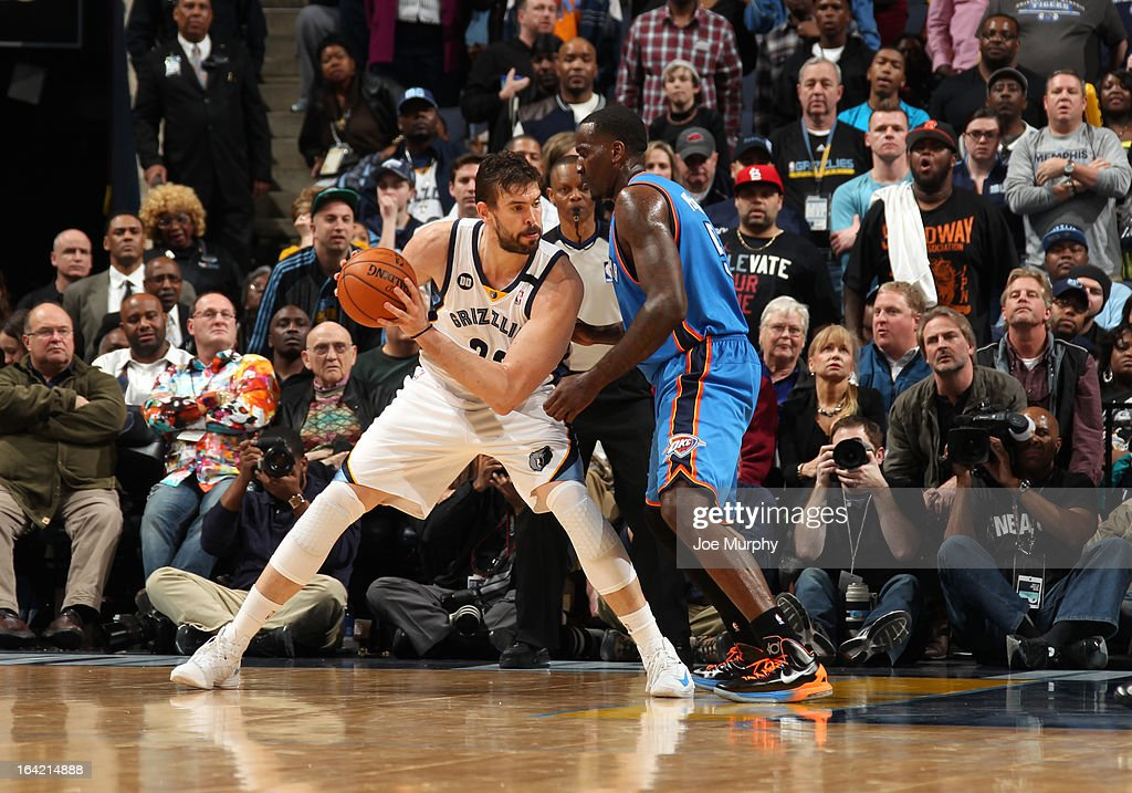 Marc Gasol #33 of the Memphis Grizzlies controls the ball against Kendrick Perkins #5 of the Oklahoma City Thunder on March 20, 2013 at FedExForum in Memphis, Tennessee.