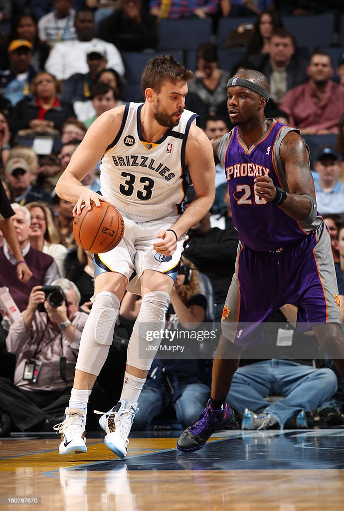 Marc Gasol #33 of the Memphis Grizzlies controls the ball against Jermaine O'Neal #20 of the Phoenix Suns on February 5, 2013 at FedExForum in Memphis, Tennessee.