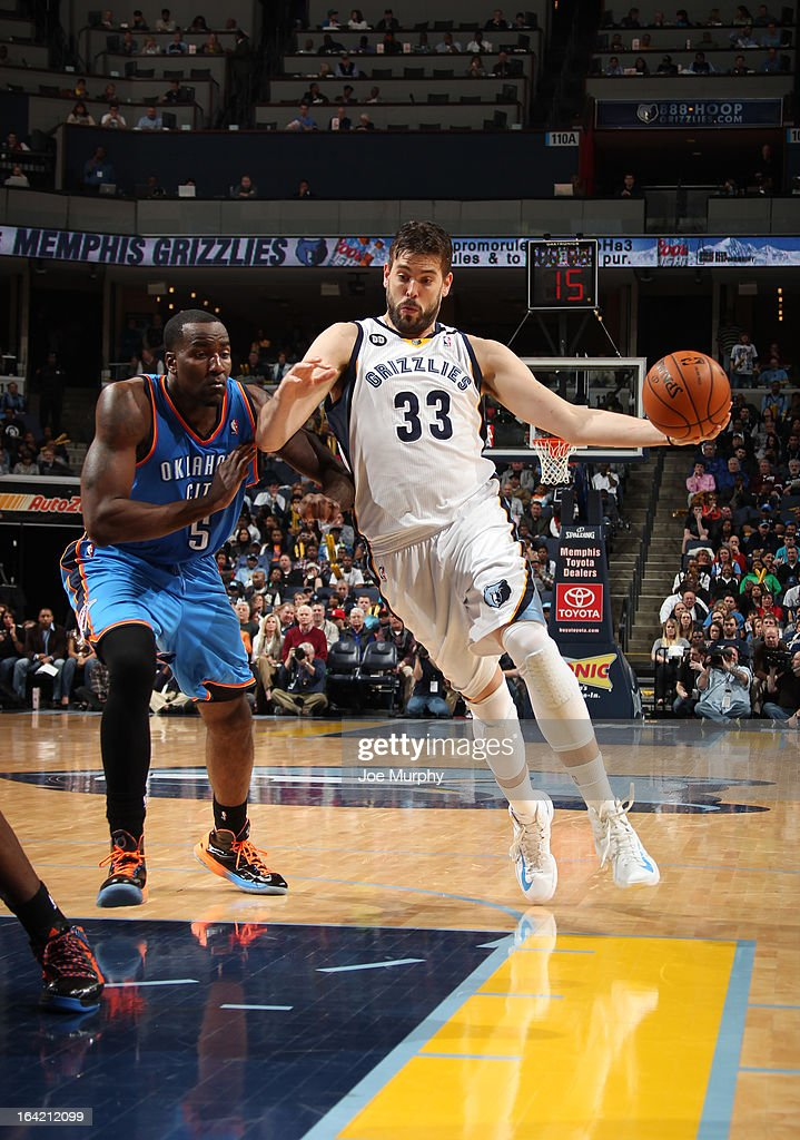 Marc Gasol #33 of the Memphis Grizzlies drives against Kendrick Perkins #5 of the Oklahoma City Thunder on March 20, 2013 at FedExForum in Memphis, Tennessee.