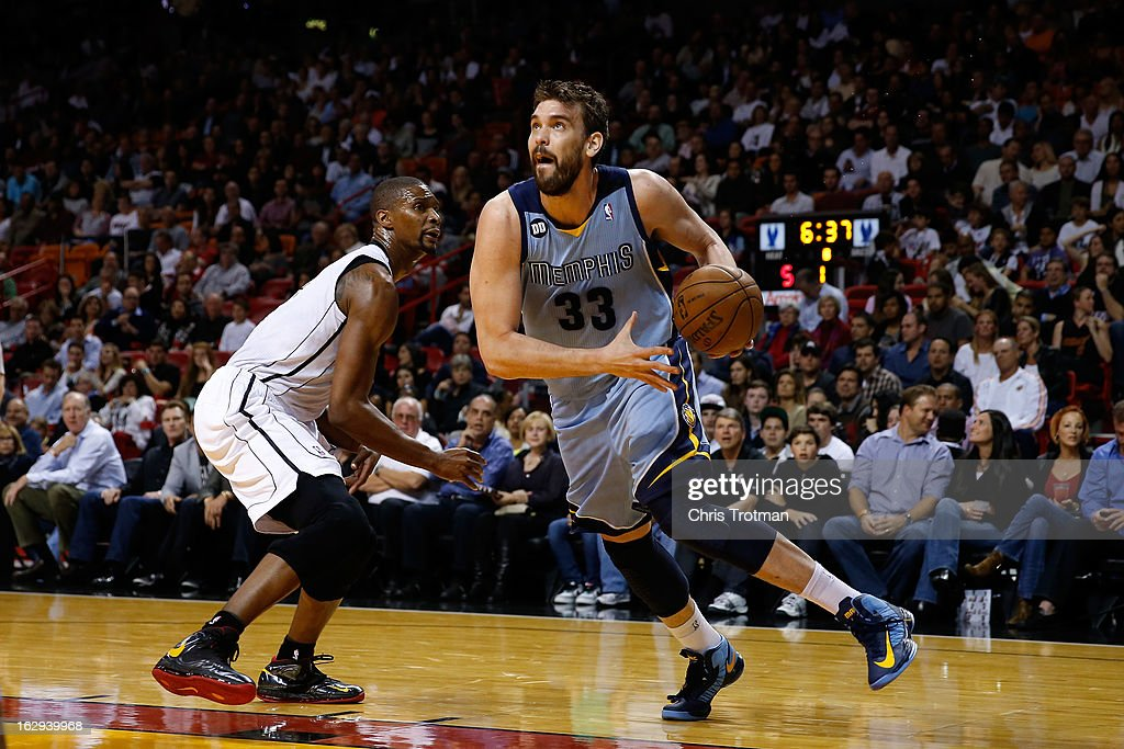 Marc Gasol #33 of the Memphis Grizzlies drives past Chris Bosh #1 of the Miami Heat at American Airlines Arena on March 1, 2013 in Miami, Florida.