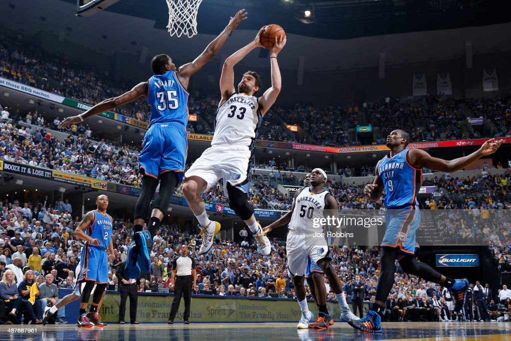 <a gi-track='captionPersonalityLinkClicked' href=/galleries/search?phrase=Marc+Gasol&family=editorial&specificpeople=661205 ng-click='$event.stopPropagation()'>Marc Gasol</a> #33 of the Memphis Grizzlies drives to the basket against <a gi-track='captionPersonalityLinkClicked' href=/galleries/search?phrase=Kevin+Durant&family=editorial&specificpeople=3847329 ng-click='$event.stopPropagation()'>Kevin Durant</a> #35 of the Oklahoma City Thunder during Game Six of the Western Conference Quarterfinals of the 2014 NBA Playoffs on May 1, 2014 at FedEx Forum in Memphis, Tennessee.