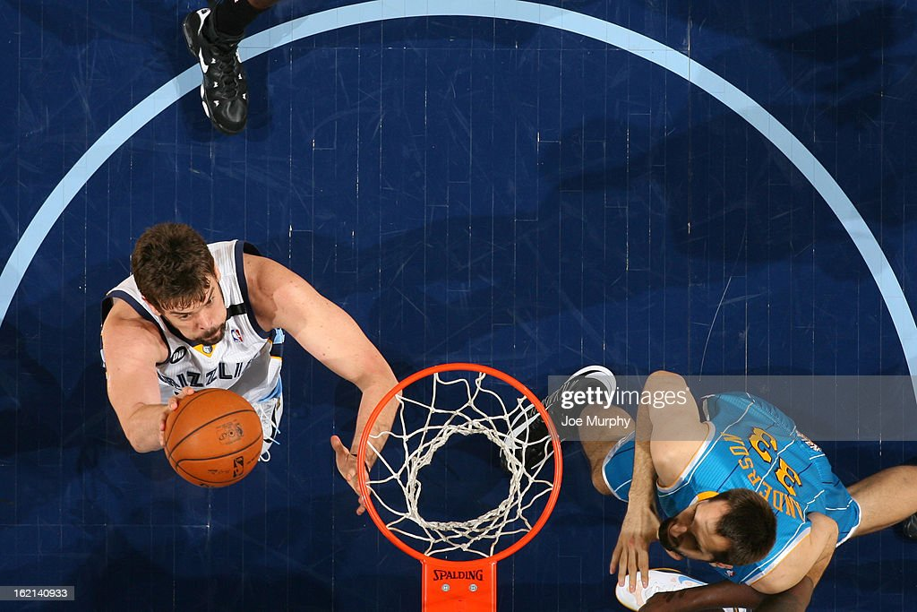 <a gi-track='captionPersonalityLinkClicked' href=/galleries/search?phrase=Marc+Gasol&family=editorial&specificpeople=661205 ng-click='$event.stopPropagation()'>Marc Gasol</a> #33 of the Memphis Grizzlies drives to the basket against the New Orleans Hornets on January 27, 2013 at FedExForum in Memphis, Tennessee.