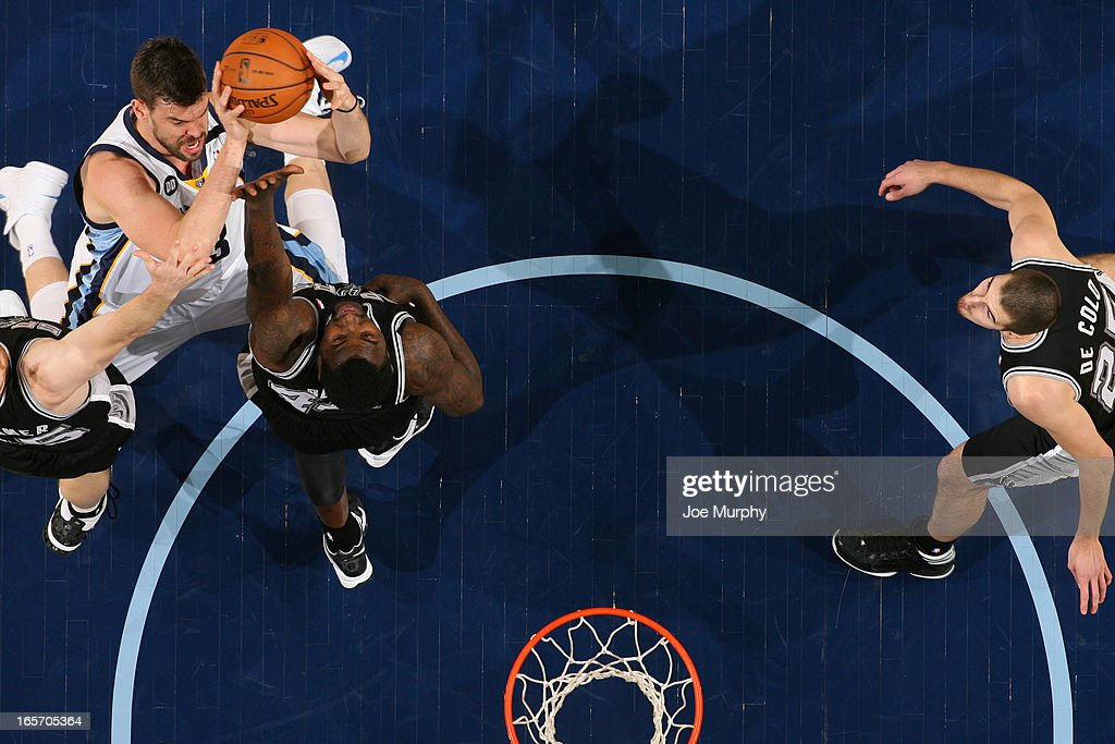 <a gi-track='captionPersonalityLinkClicked' href=/galleries/search?phrase=Marc+Gasol&family=editorial&specificpeople=661205 ng-click='$event.stopPropagation()'>Marc Gasol</a> #33 of the Memphis Grizzlies drives to the basket against the San Antonio Spurs on April 1, 2013 at FedExForum in Memphis, Tennessee.