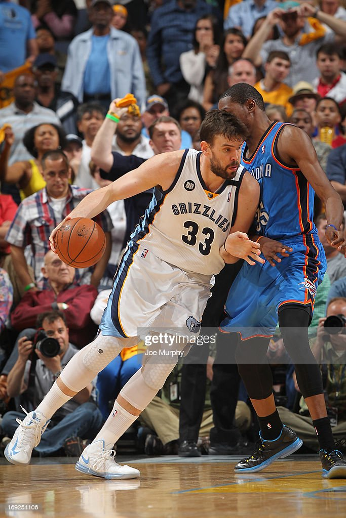 <a gi-track='captionPersonalityLinkClicked' href=/galleries/search?phrase=Marc+Gasol&family=editorial&specificpeople=661205 ng-click='$event.stopPropagation()'>Marc Gasol</a> #33 of the Memphis Grizzlies drives to the basket against the Oklahoma City Thunder in Game Three of the Western Conference Semifinals during the 2013 NBA Playoffs on May 11, 2013 at FedExForum in Memphis, Tennessee.