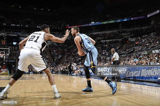 Marc Gasol of the Memphis Grizzlies drives to the basket against Tim Duncan of the San Antonio Spurs on March 29 2015 at the ATT Center in San...