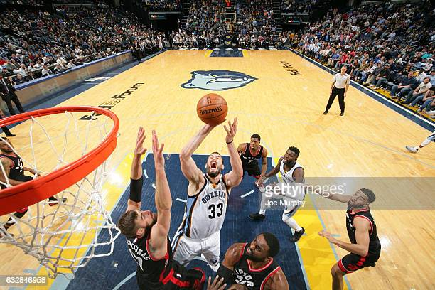 Marc Gasol of the Memphis Grizzlies drives to the basket and shoots the ball against the Toronto Raptors on January 25 2017 at FedExForum in Memphis...