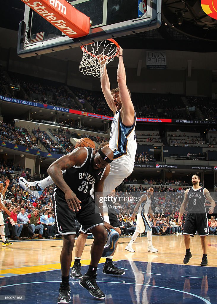 Marc Gasol #33 of the Memphis Grizzlies dunks against Reggie Evans #30 of the Brooklyn Nets on January 25, 2013 at FedExForum in Memphis, Tennessee.