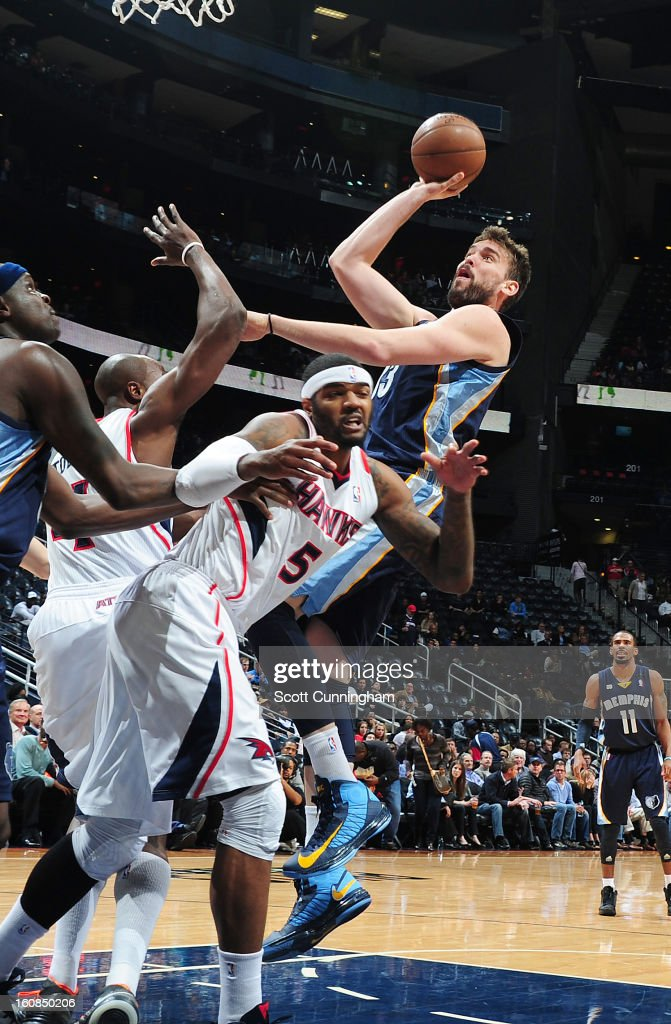 Marc Gasol #33 of the Memphis Grizzlies goes to the basket against Josh Smith #5 of the Atlanta Hawks during the game between the Atlanta Hawks and the Memphis Grizzlies on February 6, 2013 at Philips Arena in Atlanta, Georgia.