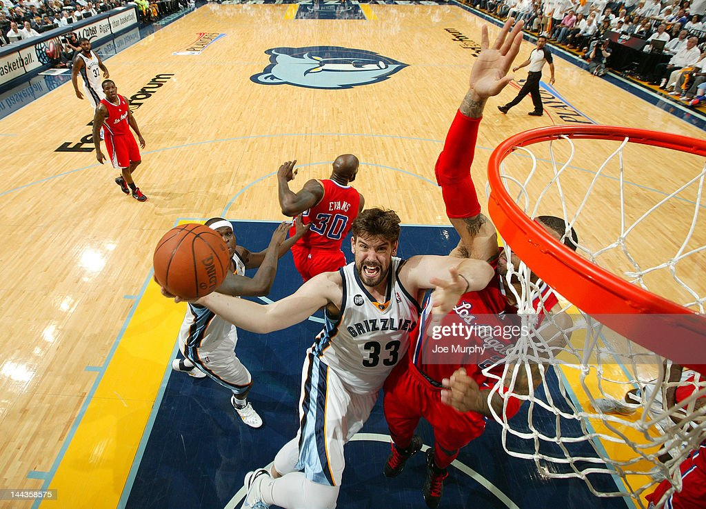Marc Gasol #33 of the Memphis Grizzlies goes to the basket against Kenyon Martin #2 of the Los Angeles Clippers in Game Seven of the Western Conference Quarterfinals during the 2012 NBA Playoffs on May 13, 2012 at FedExForum in Memphis, Tennessee.