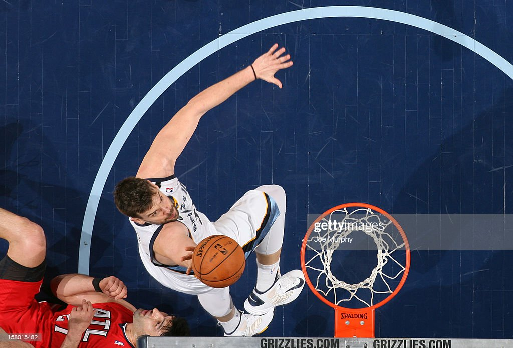 <a gi-track='captionPersonalityLinkClicked' href=/galleries/search?phrase=Marc+Gasol&family=editorial&specificpeople=661205 ng-click='$event.stopPropagation()'>Marc Gasol</a> #33 of the Memphis Grizzlies goes to the basket against the Atlanta Hawks on December 8, 2012 at FedExForum in Memphis, Tennessee.
