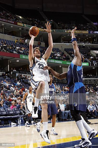 Marc Gasol of the Memphis Grizzlies goes up for a shot against Erick Dampier of the Dallas Mavericks during the game at the FedExForum on December 4...