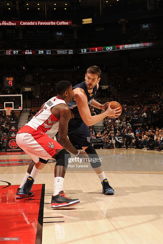 <a gi-track='captionPersonalityLinkClicked' href=/galleries/search?phrase=Marc+Gasol&family=editorial&specificpeople=661205 ng-click='$event.stopPropagation()'>Marc Gasol</a> #33 of the Memphis Grizzlies handles the ball against <a gi-track='captionPersonalityLinkClicked' href=/galleries/search?phrase=Amir+Johnson&family=editorial&specificpeople=556786 ng-click='$event.stopPropagation()'>Amir Johnson</a> #15 of the Toronto Raptors during the game on October 23, 2013 at the Air Canada Centre in Toronto, Ontario, Canada.