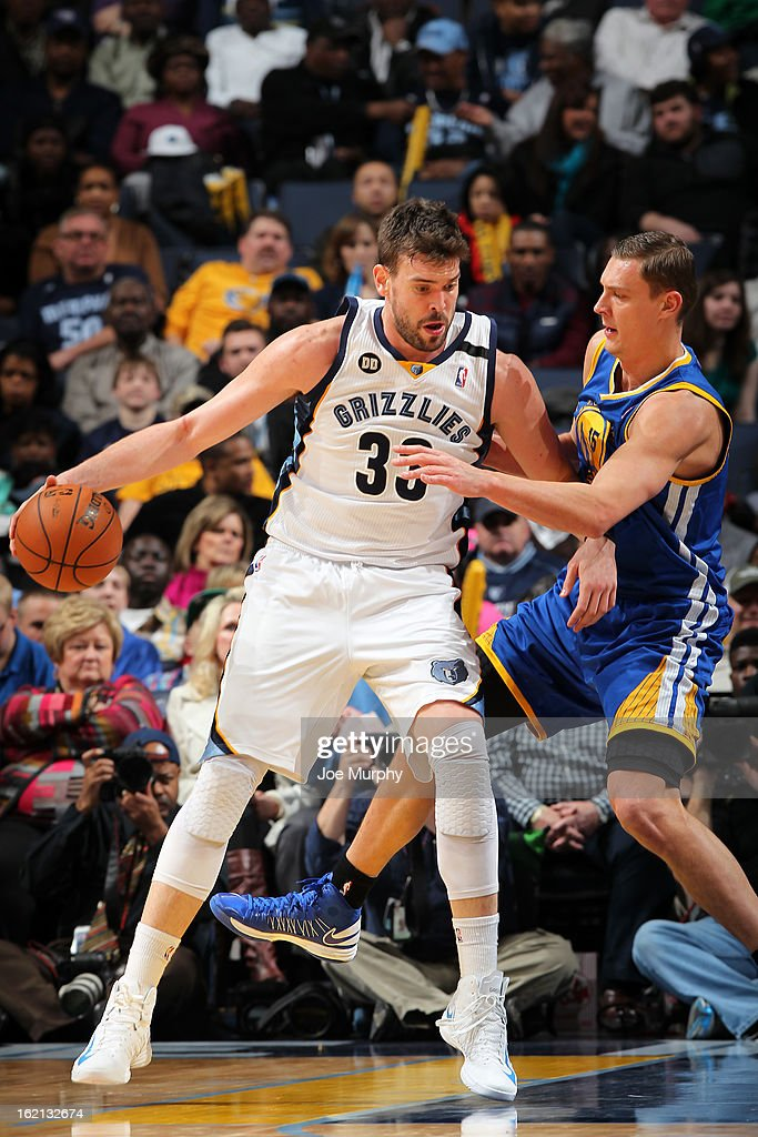 <a gi-track='captionPersonalityLinkClicked' href=/galleries/search?phrase=Marc+Gasol&family=editorial&specificpeople=661205 ng-click='$event.stopPropagation()'>Marc Gasol</a> #33 of the Memphis Grizzlies handles the ball against <a gi-track='captionPersonalityLinkClicked' href=/galleries/search?phrase=Andris+Biedrins&family=editorial&specificpeople=204473 ng-click='$event.stopPropagation()'>Andris Biedrins</a> #15 of the Golden State Warriors on February 8, 2013 at FedExForum in Memphis, Tennessee.