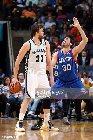Marc Gasol of the Memphis Grizzlies handles the ball against Byron Mullens of the Philadelphia 76ers on April 11 2014 at FedExForum in Memphis...