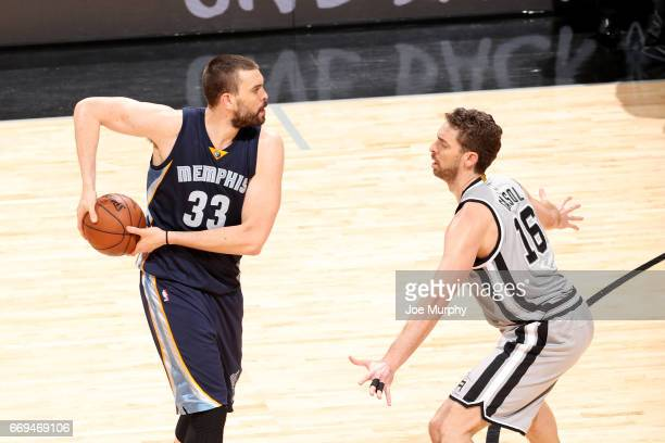 Marc Gasol of the Memphis Grizzlies handles the ball against Pau Gasol of the San Antonio Spurs in Game One of Round One of the NBA Playoffs on April...