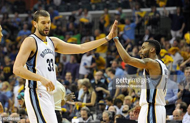 Marc Gasol of the Memphis Grizzlies high fives teammate Mike Conley in the second quarter of Game One against the Portland Trailblazers in the first...