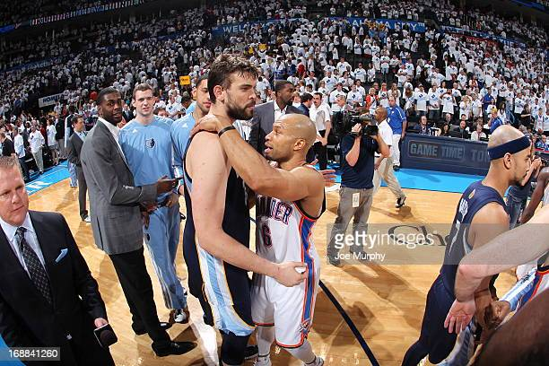 Marc Gasol of the Memphis Grizzlies hugs Derek Fisher of the Oklahoma City Thunder after Game Five of the Western Conference Semifinals during the...