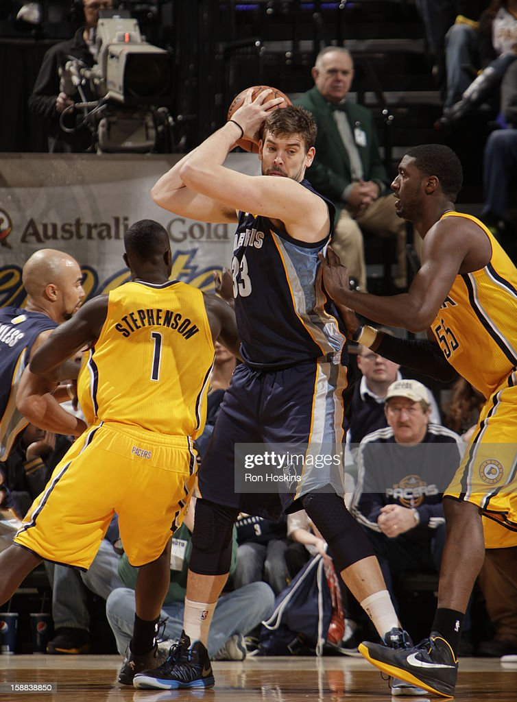 <a gi-track='captionPersonalityLinkClicked' href=/galleries/search?phrase=Marc+Gasol&family=editorial&specificpeople=661205 ng-click='$event.stopPropagation()'>Marc Gasol</a> #33 of the Memphis Grizzlies looks to drive to the basket against the Indiana Pacers on December 31, 2012 at Bankers Life Fieldhouse in Indianapolis, Indiana.
