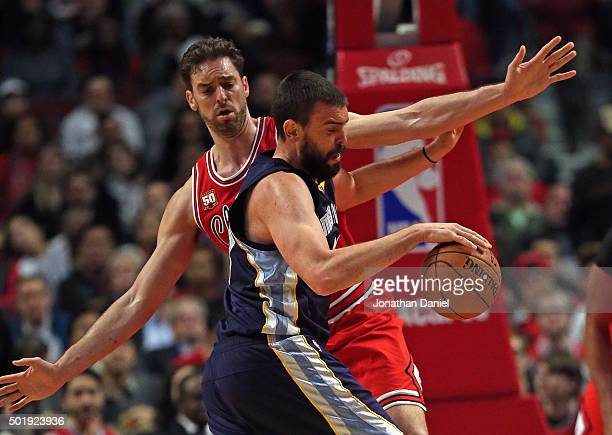 Marc Gasol of the Memphis Grizzlies moves against his brother Pau Gasol of the Chicago Bulls at the United Center on December 16 2015 in Chicago...