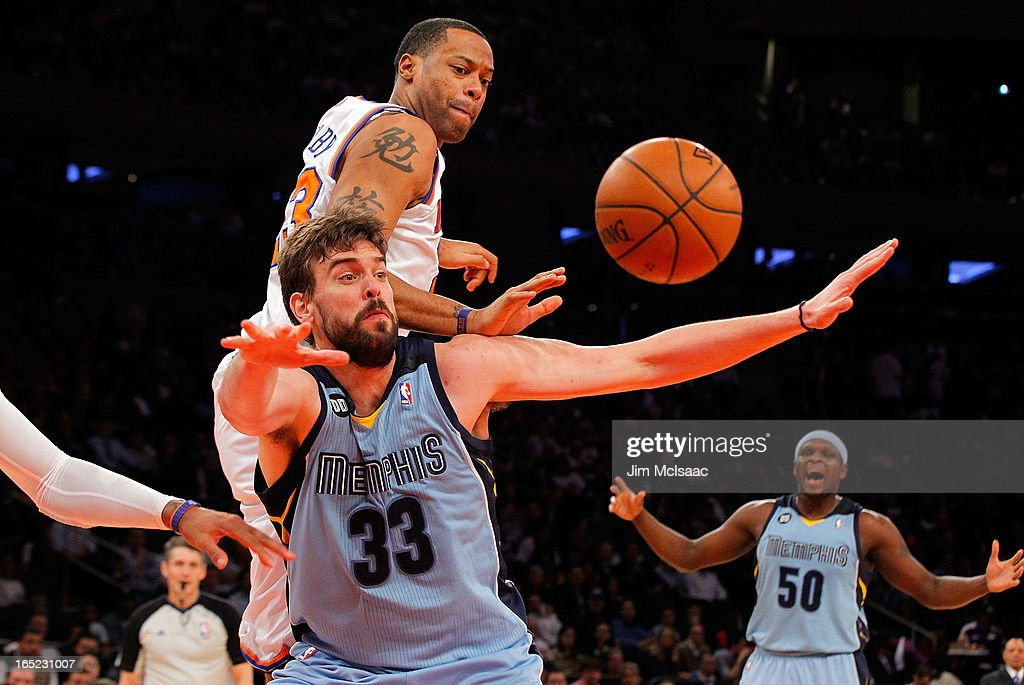 Marc Gasol #33 of the Memphis Grizzlies n action against Marcus Camby #23 of the New York Knicks at Madison Square Garden on March 27, 2013 in New York City. The Knicks defeated the Grizzlies 108-101.