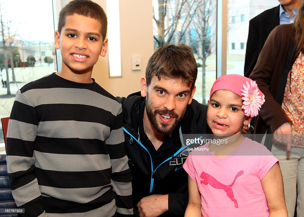 Marc Gasol #33 of the Memphis Grizzlies poses for pictures with children on February 25, 2013 at St. Jude Children's Research Hospital in Memphis, Tennessee.