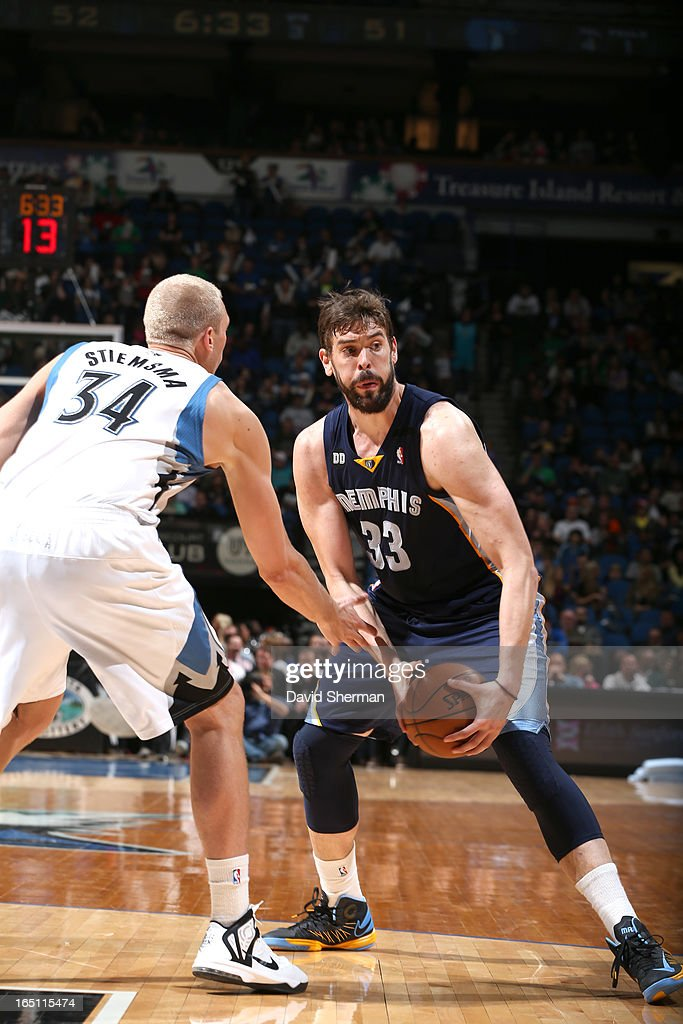 Marc Gasol #33 of the Memphis Grizzlies protects the ball from Greg Stiemsma #34 of the Minnesota Timberwolves during the game between the Memphis Grizzlies and the Minnesota Timberwolves on March 30, 2013 at Target Center in Minneapolis, Minnesota.