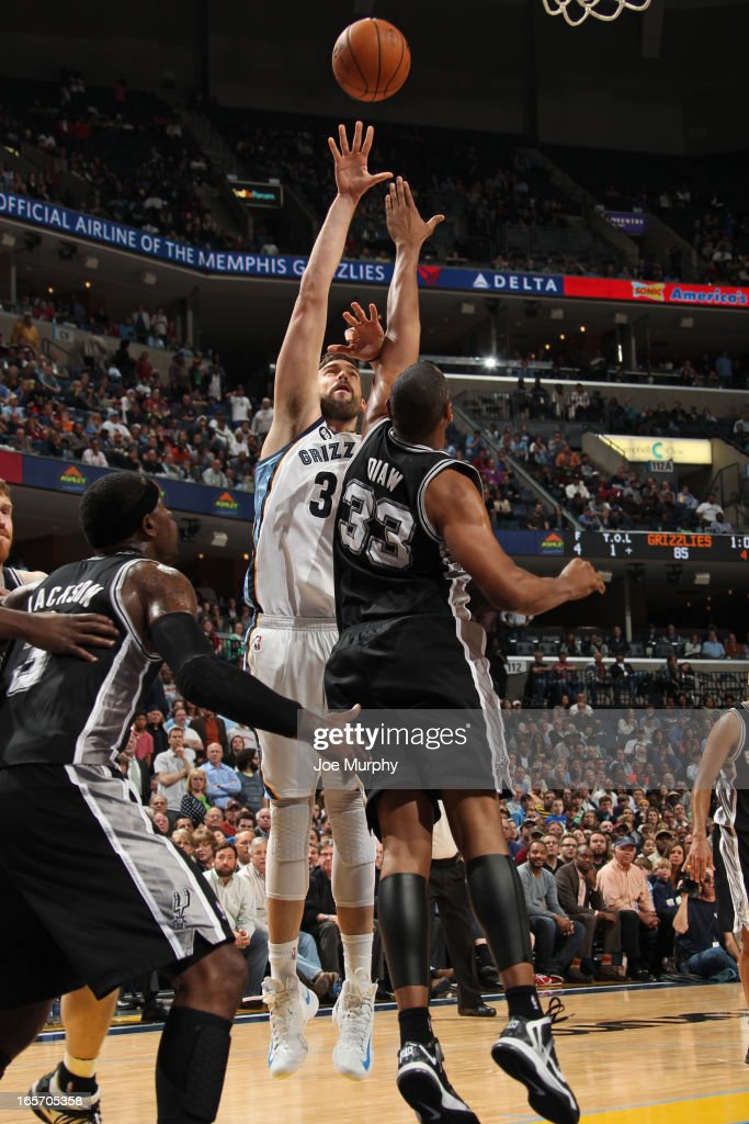 <a gi-track='captionPersonalityLinkClicked' href=/galleries/search?phrase=Marc+Gasol&family=editorial&specificpeople=661205 ng-click='$event.stopPropagation()'>Marc Gasol</a> #33 of the Memphis Grizzlies puts up a shot against the San Antonio Spurs on April 1, 2013 at FedExForum in Memphis, Tennessee.