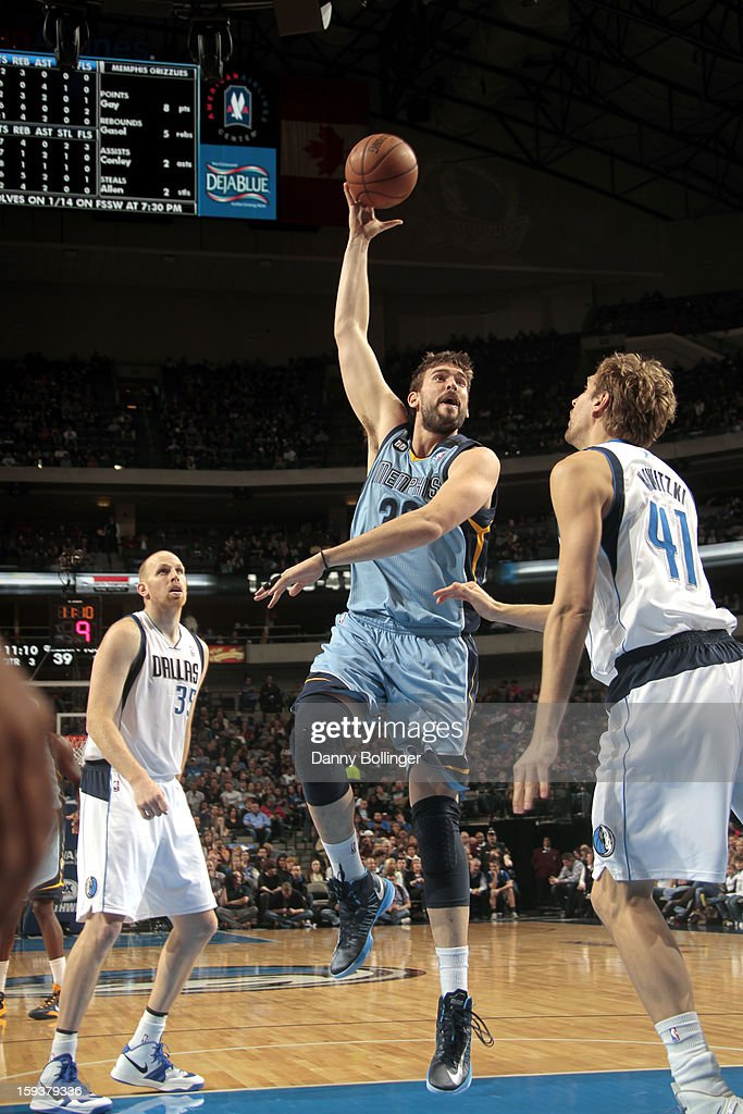 <a gi-track='captionPersonalityLinkClicked' href=/galleries/search?phrase=Marc+Gasol&family=editorial&specificpeople=661205 ng-click='$event.stopPropagation()'>Marc Gasol</a> #33 of the Memphis Grizzlies puts up the hook against <a gi-track='captionPersonalityLinkClicked' href=/galleries/search?phrase=Dirk+Nowitzki&family=editorial&specificpeople=201490 ng-click='$event.stopPropagation()'>Dirk Nowitzki</a> #41 of the Dallas Mavericks on January 12, 2013 at the American Airlines Center in Dallas, Texas.