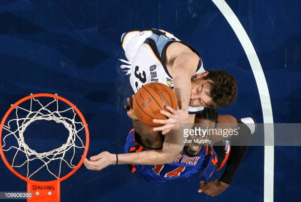 Marc Gasol of the Memphis Grizzlies rebounds against Ronnie Turiaf of the New York Knicks on March 9 2011 at FedExForum in Memphis Tennessee NOTE TO...