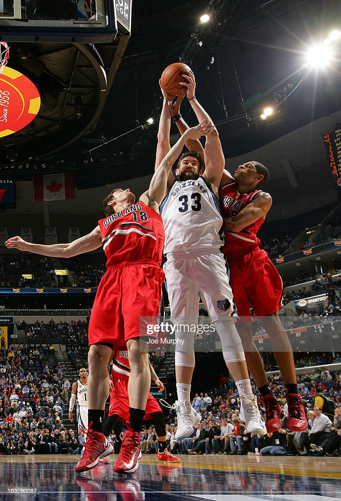 Marc Gasol #33 of the Memphis Grizzlies rebounds against Victor Claver #18 and Nicolas Batum #88 of the Portland Trail Blazers on March 6, 2013 at FedExForum in Memphis, Tennessee.