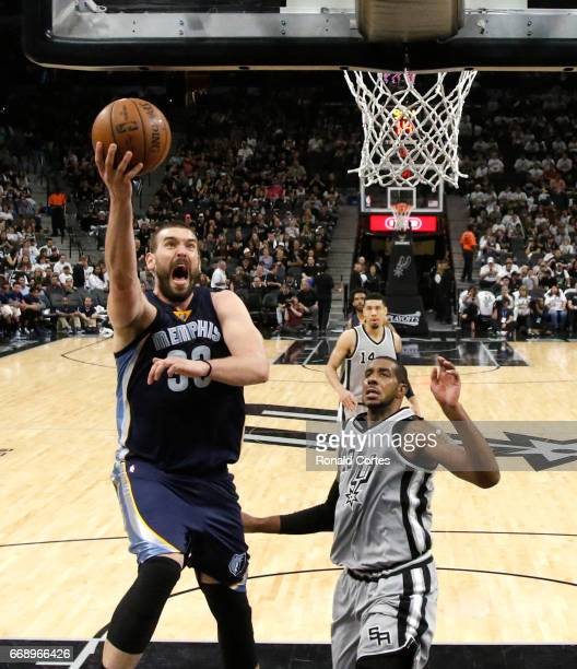 Marc Gasol of the Memphis Grizzlies scores in front of LaMarcus Aldridge of the San Antonio Spurs in Game One of the Western Conference Quarterfinals...