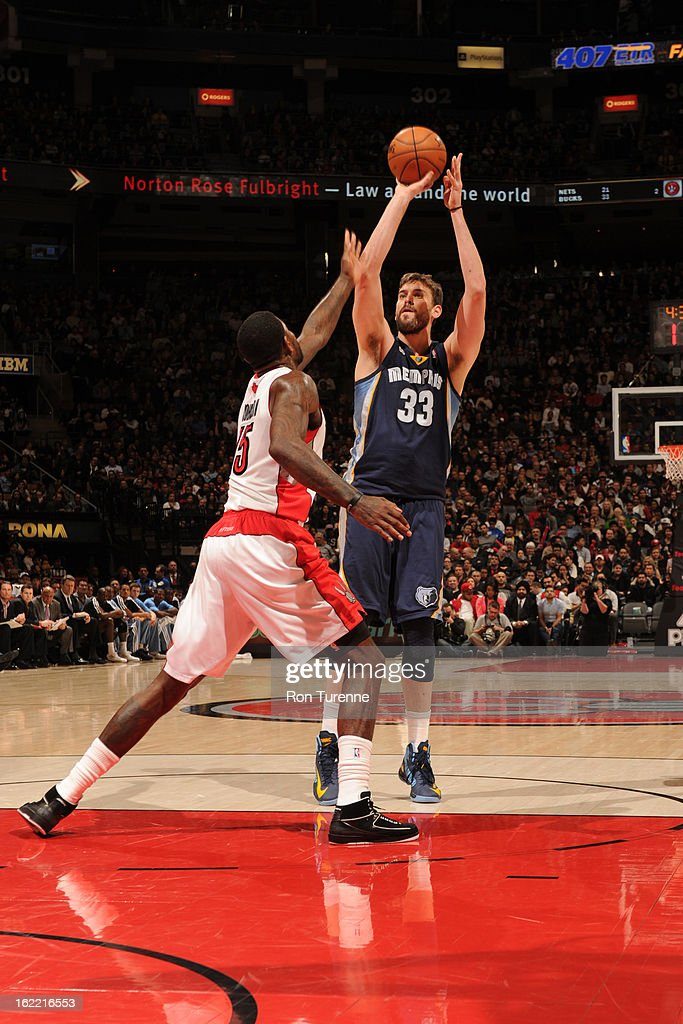 Marc Gasol #33 of the Memphis Grizzlies shoots against Amir Johnson #15 of the Toronto Raptors on February 20, 2013 at the Air Canada Centre in Toronto, Ontario, Canada.