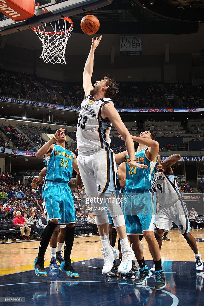 <a gi-track='captionPersonalityLinkClicked' href=/galleries/search?phrase=Marc+Gasol&family=editorial&specificpeople=661205 ng-click='$event.stopPropagation()'>Marc Gasol</a> #33 of the Memphis Grizzlies shoots against Anthony Davis #23 and <a gi-track='captionPersonalityLinkClicked' href=/galleries/search?phrase=Greivis+Vasquez&family=editorial&specificpeople=4066977 ng-click='$event.stopPropagation()'>Greivis Vasquez</a> #21 of the New Orleans Hornets on March 9, 2013 at FedExForum in Memphis, Tennessee.