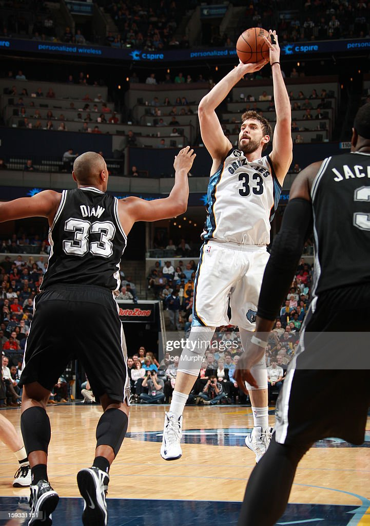 Marc Gasol #33 of the Memphis Grizzlies shoots against Boris Diaw #33 of the San Antonio Spurs on January 11, 2013 at FedExForum in Memphis, Tennessee.