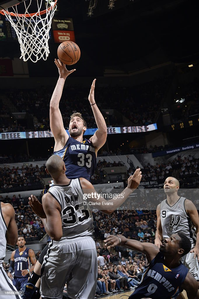 <a gi-track='captionPersonalityLinkClicked' href=/galleries/search?phrase=Marc+Gasol&family=editorial&specificpeople=661205 ng-click='$event.stopPropagation()'>Marc Gasol</a> #33 of the Memphis Grizzlies shoots against <a gi-track='captionPersonalityLinkClicked' href=/galleries/search?phrase=Boris+Diaw&family=editorial&specificpeople=201505 ng-click='$event.stopPropagation()'>Boris Diaw</a> #33 of the San Antonio Spurs at the AT&T Center on October 30, 2013 in San Antonio, Texas.
