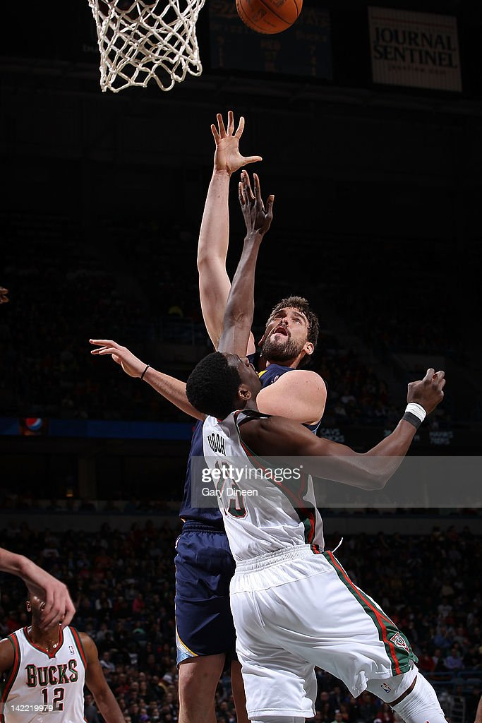 <a gi-track='captionPersonalityLinkClicked' href=/galleries/search?phrase=Marc+Gasol&family=editorial&specificpeople=661205 ng-click='$event.stopPropagation()'>Marc Gasol</a> #33 of the Memphis Grizzlies shoots against <a gi-track='captionPersonalityLinkClicked' href=/galleries/search?phrase=Ekpe+Udoh&family=editorial&specificpeople=4185351 ng-click='$event.stopPropagation()'>Ekpe Udoh</a> #13 of the Milwaukee Bucks on March 31, 2012 at the Bradley Center in Milwaukee, Wisconsin.