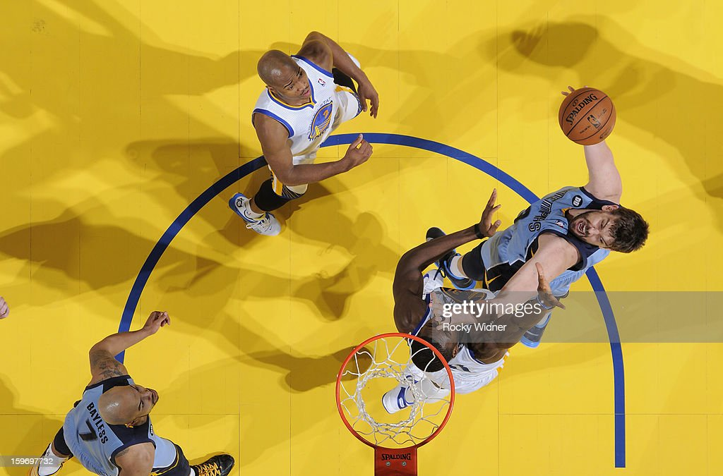 <a gi-track='captionPersonalityLinkClicked' href=/galleries/search?phrase=Marc+Gasol&family=editorial&specificpeople=661205 ng-click='$event.stopPropagation()'>Marc Gasol</a> #33 of the Memphis Grizzlies shoots against <a gi-track='captionPersonalityLinkClicked' href=/galleries/search?phrase=Festus+Ezeli&family=editorial&specificpeople=5725219 ng-click='$event.stopPropagation()'>Festus Ezeli</a> #31 of the Golden State Warriors on January 9, 2013 at Oracle Arena in Oakland, California.