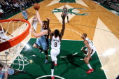 Marc Gasol of the Memphis Grizzlies shoots against Larry Sanders of the Milwaukee Bucks on January 1 2014 at the BMO Harris Bradley Center in...