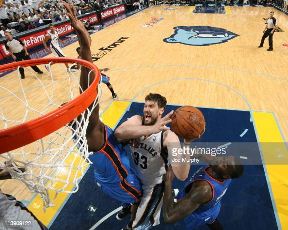 Marc Gasol of the Memphis Grizzlies shoots against Nazr Mohammed and Kendrick Perkins of the Oklahoma City Thunder during Game Four of the Western...