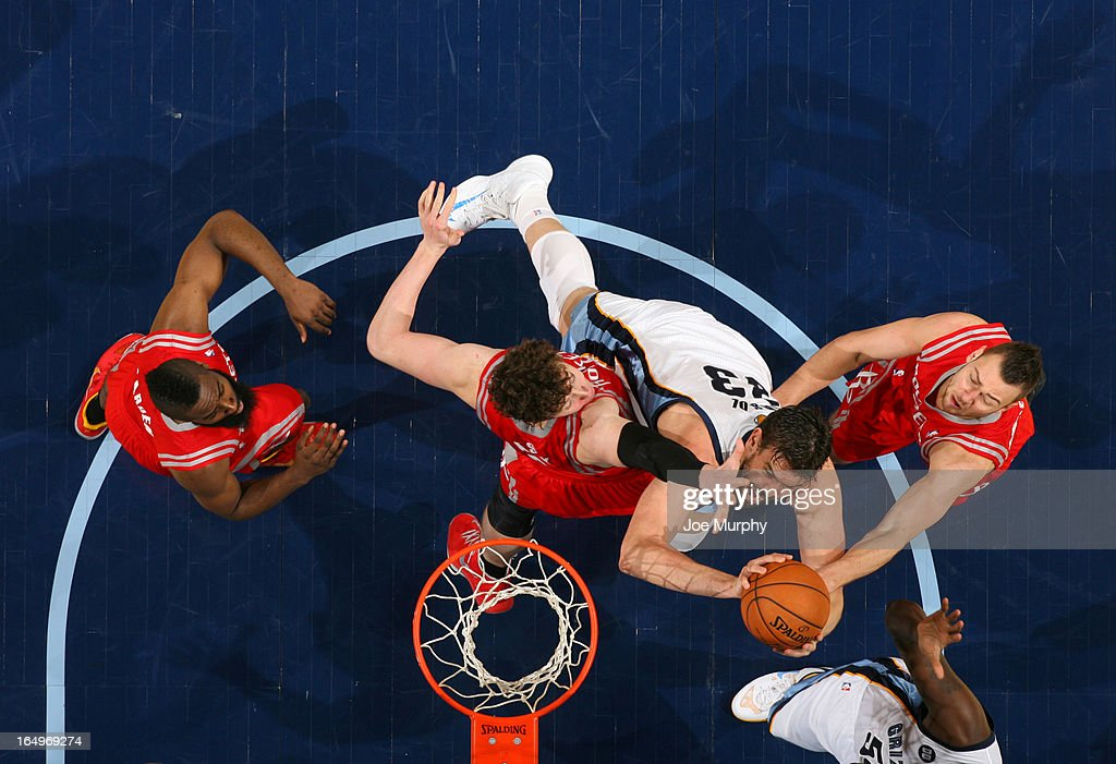 Marc Gasol #33 of the Memphis Grizzlies shoots against Omer Asik #3 and Donatas Motiejunas #20 of the Houston Rockets on March 29, 2013 at FedExForum in Memphis, Tennessee.