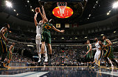 Marc Gasol of the Memphis Grizzlies shoots against Rudy Gobert of the Utah Jazz on December 22 2014 at FedExForum in Memphis Tennessee NOTE TO USER...