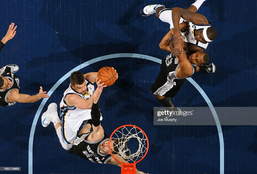 <a gi-track='captionPersonalityLinkClicked' href=/galleries/search?phrase=Marc+Gasol&family=editorial&specificpeople=661205 ng-click='$event.stopPropagation()'>Marc Gasol</a> #33 of the Memphis Grizzlies shoots against <a gi-track='captionPersonalityLinkClicked' href=/galleries/search?phrase=Tiago+Splitter&family=editorial&specificpeople=208218 ng-click='$event.stopPropagation()'>Tiago Splitter</a> #22 of the San Antonio Spurs on April 1, 2013 at FedExForum in Memphis, Tennessee.
