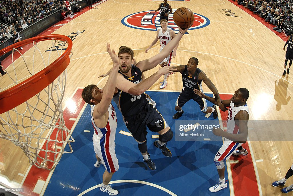 Marc Gasol of the Memphis Grizzlies shoots against Viacheslav Kravtsov of the Detroit Pistons on February 19 2013 at The Palace of Auburn Hills in...