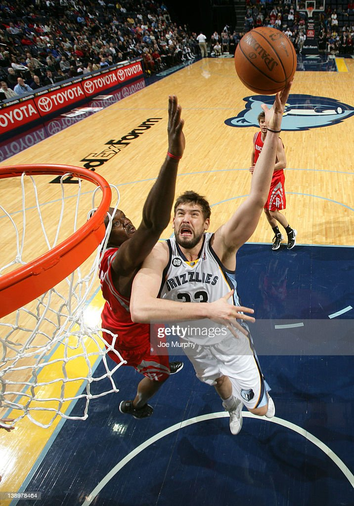 <a gi-track='captionPersonalityLinkClicked' href=/galleries/search?phrase=Marc+Gasol&family=editorial&specificpeople=661205 ng-click='$event.stopPropagation()'>Marc Gasol</a> #33 of the Memphis Grizzlies shoots around <a gi-track='captionPersonalityLinkClicked' href=/galleries/search?phrase=Samuel+Dalembert&family=editorial&specificpeople=202026 ng-click='$event.stopPropagation()'>Samuel Dalembert</a> #21 of the Houston Rockets on February 14, 2012 at FedExForum in Memphis, Tennessee.