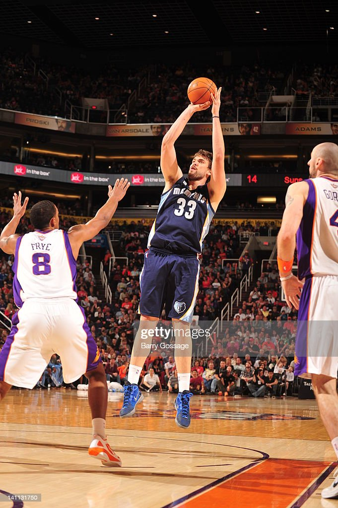 <a gi-track='captionPersonalityLinkClicked' href=/galleries/search?phrase=Marc+Gasol&family=editorial&specificpeople=661205 ng-click='$event.stopPropagation()'>Marc Gasol</a> #33 of the Memphis Grizzlies shoots over <a gi-track='captionPersonalityLinkClicked' href=/galleries/search?phrase=Channing+Frye&family=editorial&specificpeople=206815 ng-click='$event.stopPropagation()'>Channing Frye</a> #8 of the Phoenix Suns in an NBA game played on March 10, 2012 at U.S. Airways Center in Phoenix, Arizona.
