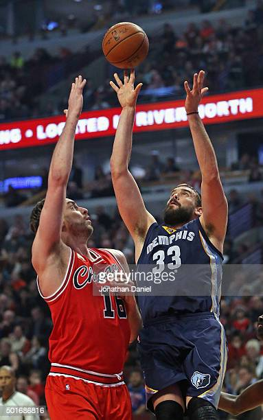 Marc Gasol of the Memphis Grizzlies shoots over his brother Pau Gasol of the Chicago Bulls at the United Center on December 16 2015 in Chicago...