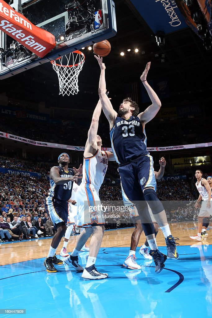 Marc Gasol #33 of the Memphis Grizzlies shoots over the Oklahoma City Thunder during an NBA game on January 31, 2013 at the Chesapeake Energy Arena in Oklahoma City, Oklahoma.