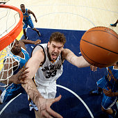 Marc Gasol of the Memphis Grizzlies shoots the ball against Emeka Okafor of the New Orleans Hornets on January 30 2010 at FedExForum in Memphis...